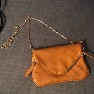 Brown purse with gold chain strap